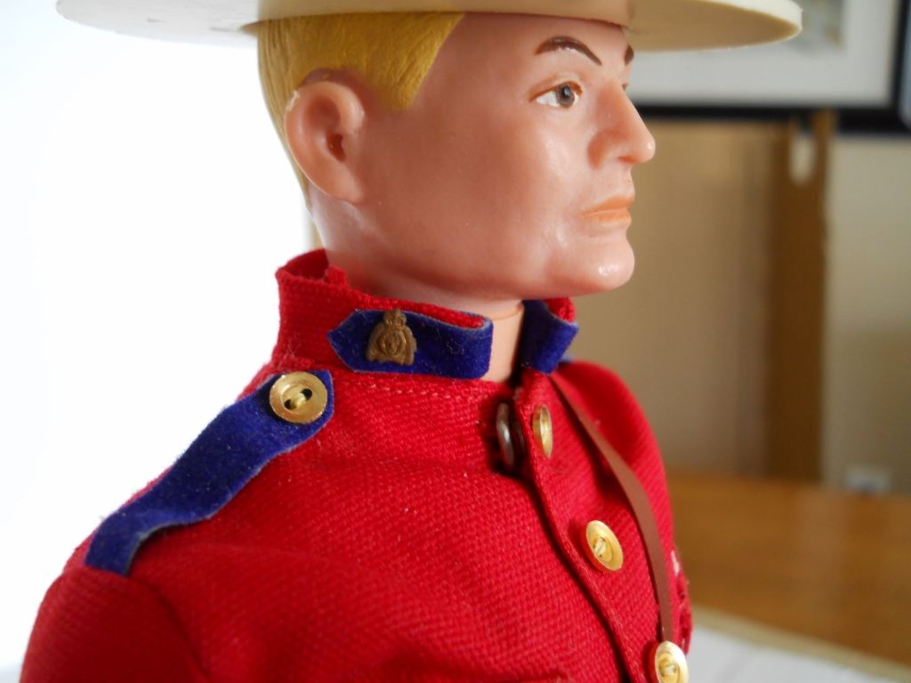 you can see the direct resemblance to the actual emblem the collar badge on the above mountie figure has become tarnished with time but the photo on the